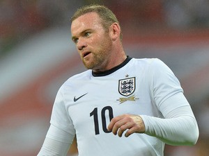 England striker Wayne Rooney plays during the international friendly football match between England and Scotland at Wembley Stadium in London on August 14, 2013