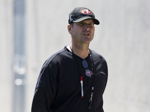 Jim Harbaugh head coach of the San Francisco 49ers enters the practice field during the San Francisco 49ers rookie minicamp at their training facility on May 10, 2013