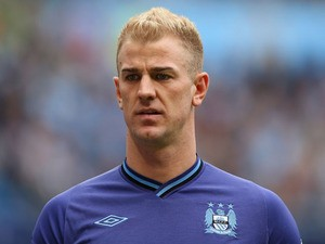 Hart of Manchester City looks on during the Barclays Premier League match between Manchester City and Norwich City at Etihad Stadium on May 19, 2013