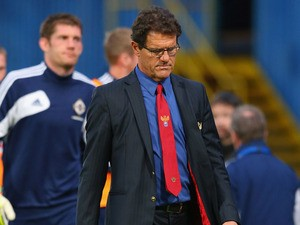 Fabio Capello the coach of Russia walks off at half time during the FIFA 2014 World Cup Group F Qualifier match between Northern Ireland and Russia at Windsor Park on August 14, 2013
