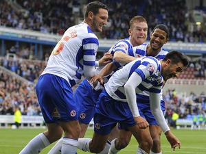 Jem Karacan of Reading celebrates with team mates after scoring the teams second goal during the Sky Bet Championship match between Reading v Watford at The Madejski Stadium on August 17, 2013