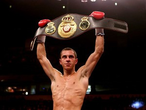 Scott Quigg celebrates his victory over Rendell Munroe during their Super Bantamweight bout at the MEN Arena on November 24, 2012