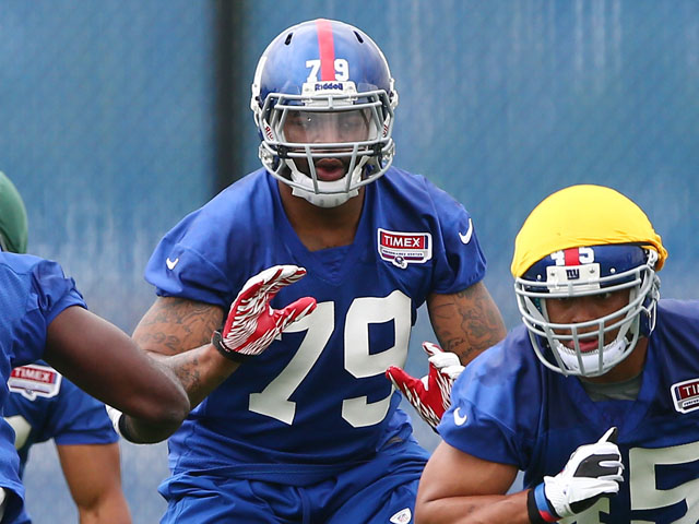 Damontre Moore of the New York Giants runs through a drill during the New York Giants Rookie Camp on May 11, 2013