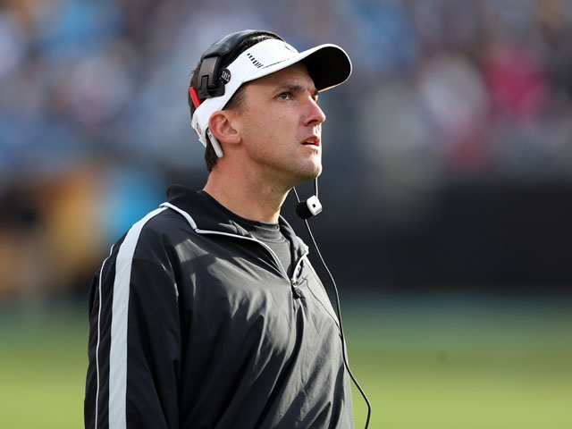 Head coach Dennis Allen of the Oakland Raiders watches on from the sidelines during their game against the Carolina Panthers at Bank of America Stadium on December 23, 2012