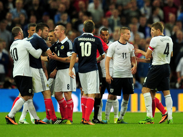 England and Scotland players confront each other during the International Friendly match between England and Scotland at Wembley Stadium on August 14, 2013