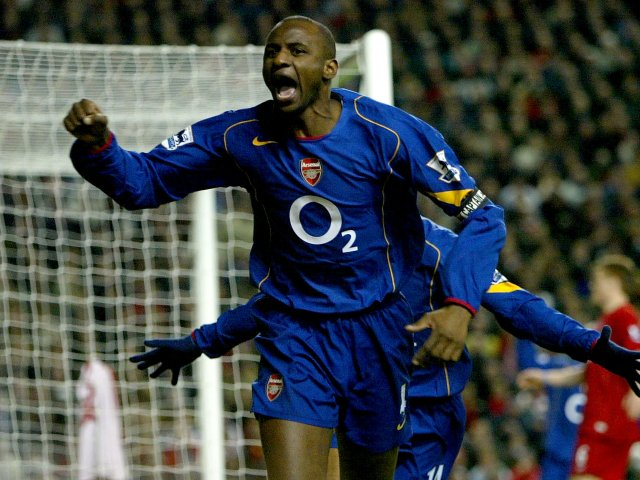 Patrick Vieira celebrates scoring for Arsenal against Liverpool at Anfield.