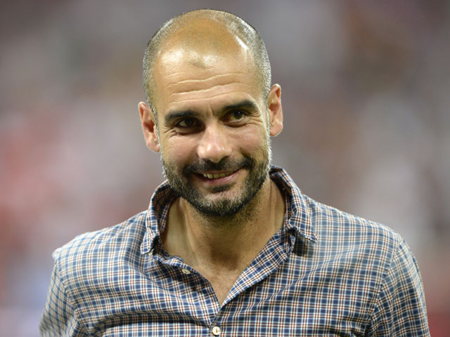 Bayern Munich's Spanish headcoach Pep Guardiola looks ahead during the awarding ceremony of the Audi Cup after the football match Bayern Munich FC vs Manchester City in Munich on August 1, 2013
