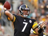 Ben Roethlisberger #7 of the Pittsburgh Steelers drops back to pass against the New York Giants during the game on August 10, 2013