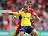 Sunderland's Craig Gardner battles for the ball against Southampton on August 24, 2013