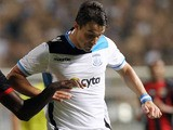Gaston Sangoy (R) of Apollon Limassol dribbles past Kevin Gomis of OGC Nice (L) during the first leg of their UEFA Europa League qualifying football match in Limassol, Cyprus on August 22, 2013