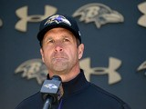 Head coach John Harbaugh of the Baltimore Ravens speaks to members of the media after a practice during the Baltimore Ravens rookie camp on May 5, 2013