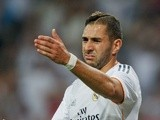 Real Madrid striker Karim Benzema responds to a teammate during a game with Real Betis on August 18, 2013