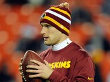 Kirk Cousins #12 of the Washington Redskins warms up prior to a game against the Dallas Cowboys at FedExField on December 30, 2012