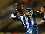 Wigan's Leon Barnett celebrates after scoring his team's equaliser during the match against Doncaster on August 20, 2013