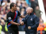 Palace's Marouane Chamakh celebrates with manager Ian Holloway after scoring the opening goal against Stoke on August 24, 2013