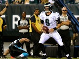 Nick Foles #9 of the Philadelphia Eagles carries the ball in for a touchdown against the Carolina Panthers on August 15, 2013