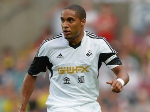 Swansea's Ashley Williams in action against Malmo on August 1, 2013