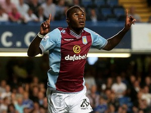 Christian Benteke of Aston Villa celebrates after scoring a goal to level the scores at 1-1 during the Barclays Premier League match between Chelsea and Aston Villa at Stamford Bridge on August 21, 2013