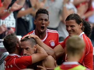 Bayern's Franck Ribery is congratulated by team mates after scoring against Nuremberg on August 24, 2013