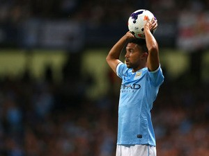 Gael Clichy of Manchester City takes a throw in during the Barclays Premier League match between Manchester City and Newcastle United at the Etihad Stadium on August 19, 2013