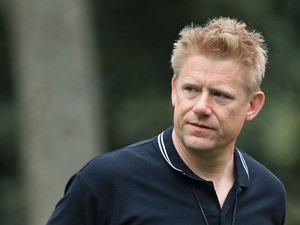 Retired Danish professional footballer Peter Schmeichel attends the final round of the 2013 Masters Tournament at Augusta National Golf Club on April 14, 2013