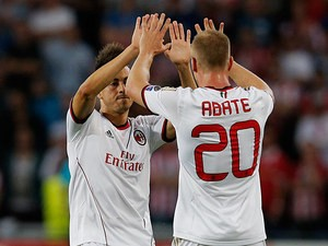 AC Milan's Stephan El Shaarawy celebrates with team mate Ignazio Abate after scoring the opening goal against PSV Eindhoven on August 20, 2013