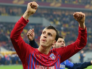 FC Steaua's Vlad Chiriches celebrates his team's win against Chelsea during the Europa League on March 7, 2013