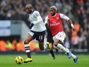 William Gallas of Tottenham is chased by Alex Song of Arsenal during the Barclays Premier League match between Arsenal and Tottenham Hotspur at the Emirates Stadium on November 20, 2010