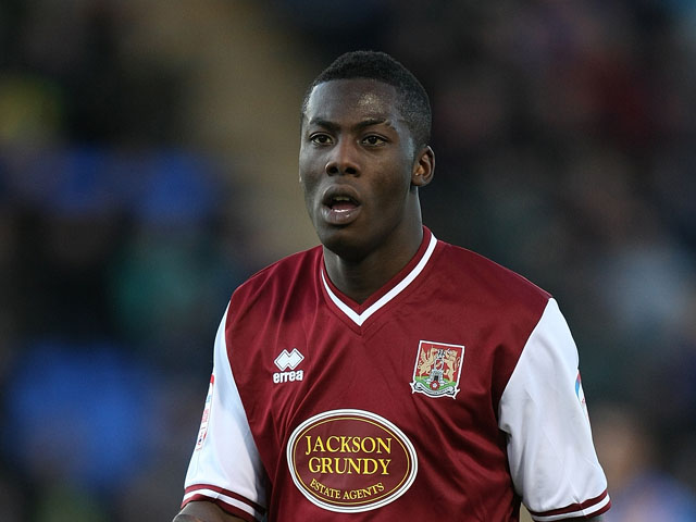 Akwasi Asante of Northampton Town in action during the npower League Two match between Shrewsbury Town and Northampton Town at the Greenhous Meadow on January 2, 2012