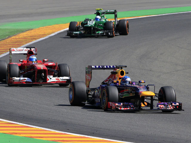 Ferrari's Spanish driver Fernando Alonso, Caterham F1 Team's Dutch driver Guido Van Der Garde and Red Bull Racing's German driver Sebastian Vettel drive during the second practice session at the Spa-Francorchamps circuit in Spa on August 23, 2013