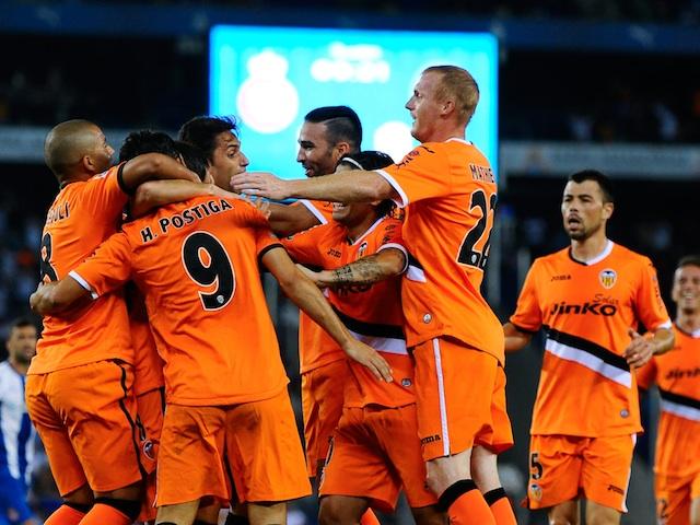 Valencia players congratulate Helder Postiga after a goal against Espanyol on August 24, 2013