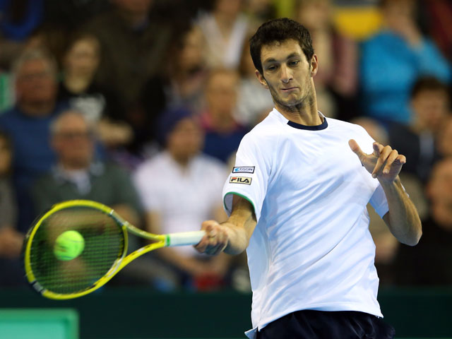 James Ward of Great Britain in action against Dmitry Tursunov of Russia during day three of the Davis Cup match between Great Britain and Russia at the Ricoh Arena on April 7, 2013