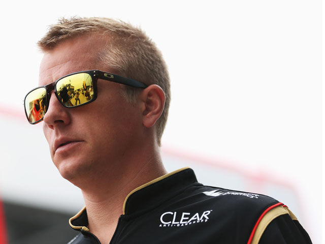 Kimi Raikkonen of Finland and Lotus is interviewed in the paddock by the media during previews to the Hungarian Formula One Grand Prix at Hungaroring on July 25, 2013