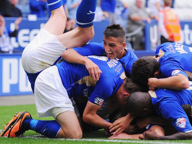 Leicester players bundle in celebration after a late winner against Birmingham City on August 24, 2013