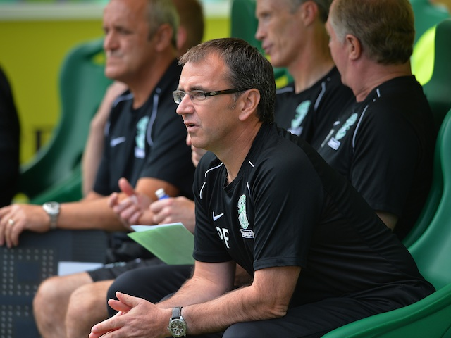 Hibs boss Pat Fenlon sits in the dugout during a game with Motherwell on August 4, 2013