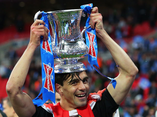 Paul Scharner of Wigan Athletic celebrates his team's victory after the FA Cup with Budweiser Final between Manchester City and Wigan Athletic at Wembley Stadium on May 11, 2013