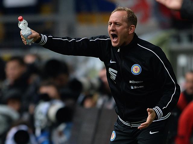 Eintracht Braunschweig head coach Torsten Lieberknecht gestures on the touchline during the match against Borussia Dortmund on August 18, 2013