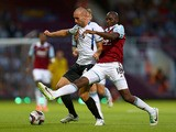Russel Penn of Cheltenham Town battles with Alou Diarra of West Ham United during the Capital One Cup second round match between West Ham United and Cheltenham Town at The Boleyn Ground on August 27, 2013