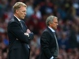 Opposing bosses David Moyes and Jose Mourinho look on as their sides do battle at Old Trafford on August 26, 2013