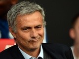 Chelsea manager Jose Mourinho takes his seat at Old Trafford on August 26, 2013