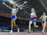Kelly Holmes crosses the line in first place to claim gold at the 2004 Olympic Games.