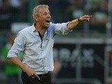 Moenchengladbach coach Lucien Favre barks orders at his team during a game with Hannover on August 17, 2013