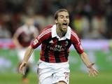 Milan midfielder Mathieu Flamini celebrates a goal against Napoli on April 14, 2013