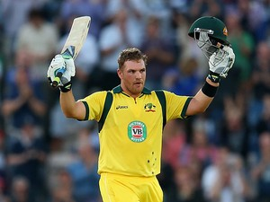 Australia's Aaron Finch celebrate his century against England during their Twenty20 International match on August 29, 2013