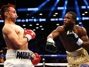 Adrien Broner swings on Paulie Malignaggi during their WBA Welterweight Title bout at Barclays Center on June 22, 2013
