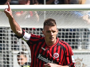 Frankfurt's Alexander Meier celebrates scoring the 1-2 by penalty during the German first division Bundesliga football match Eintracht Frankfurt vs. VfL Wolfsburg in Frankfurt, Germany, on May 18, 2013