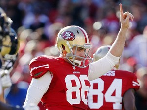 Tight end Brian Jennings #86 of the San Francisco 49ers celebrates a touchdown against the St. Louis Rams in the second quarter on November 11, 2012