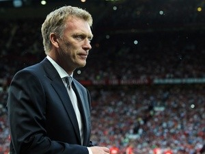 David Moyes takes to the Old Trafford dugout for the first time as Man United boss on August 26, 2013
