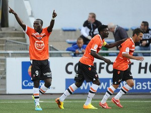 Lorient's forward Vincent Aboubakar celebrates after scoring a goal during a French Ligue 1 football match between Lorient and Valenciennes on August 31, 2013