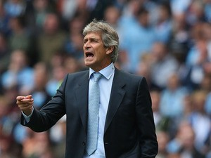Manuel Pellegrini the manager of Manchester City during the Barclays Premier League match between Manchester City and Hull City at the Etihad Stadium on August 31, 2013
